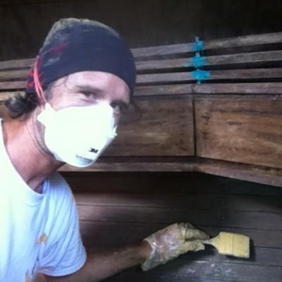 A man renovating a boat