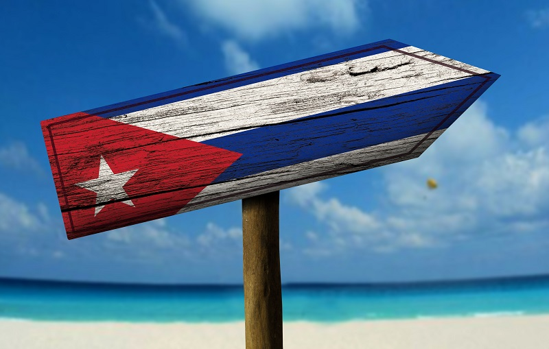 A road sign with the Cuban flag