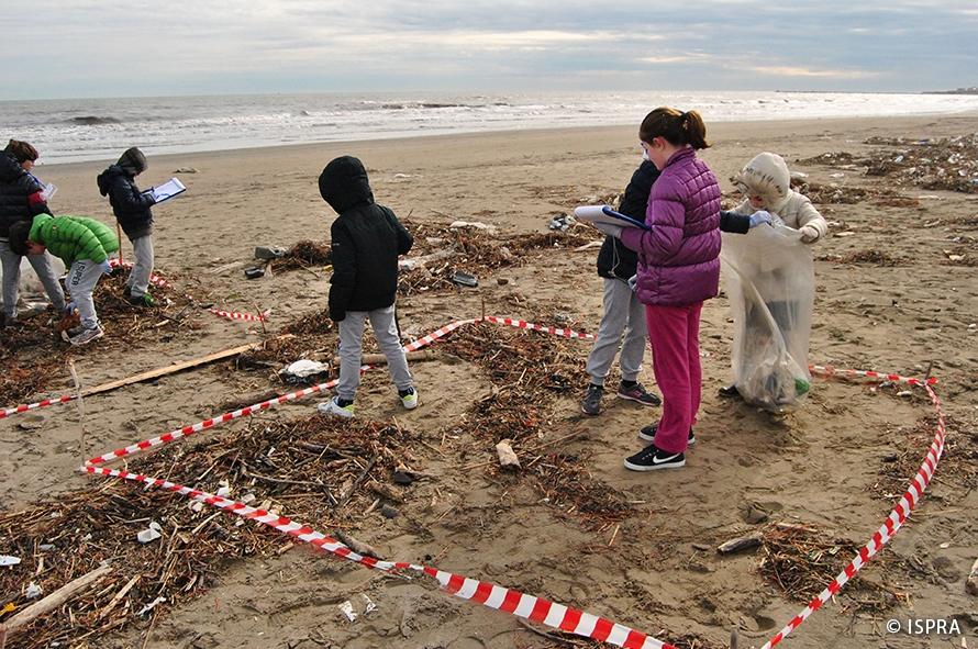 Children cleaning a beach