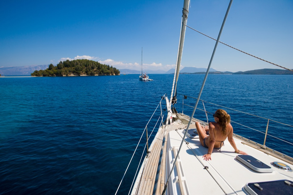A woman lying on a yacht.