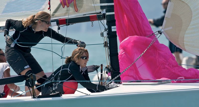 Women with knee-pads on a sailing yacht
