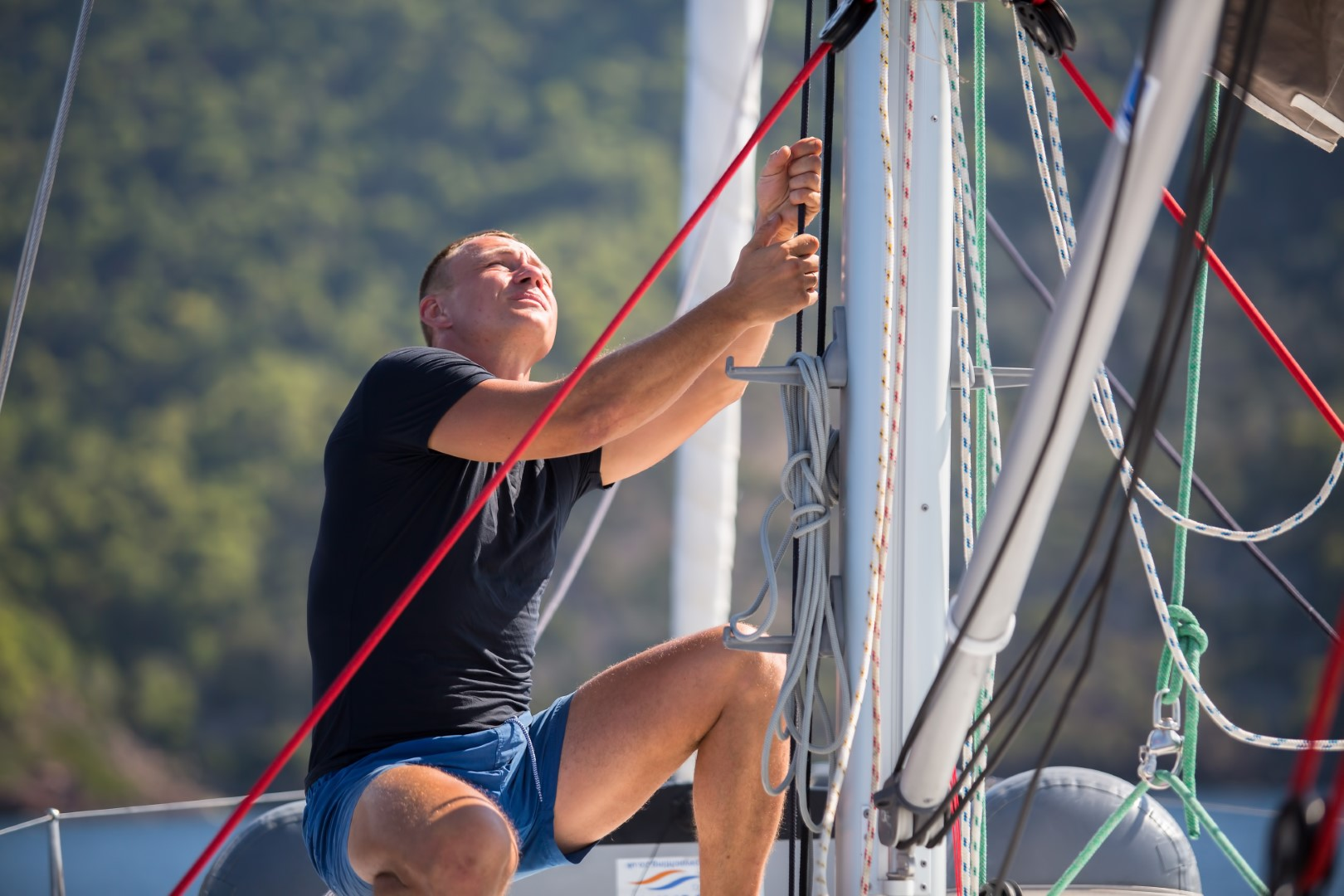 skipper-sailing-yacht-boat-ropes-man-sea