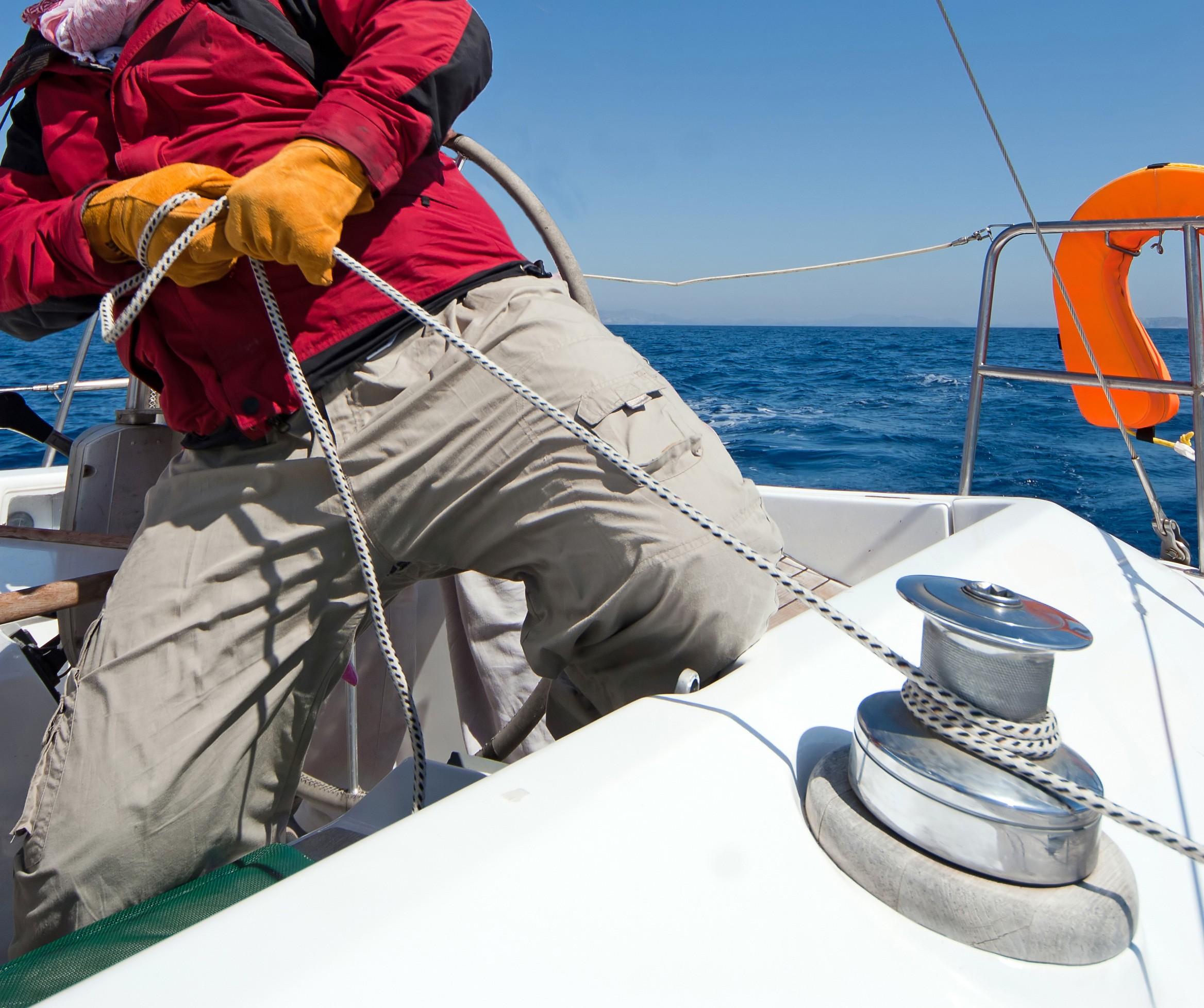 skipper-sailing-yacht-boat-ropes-sea