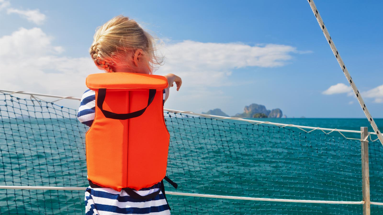 Child aboard with a life vest